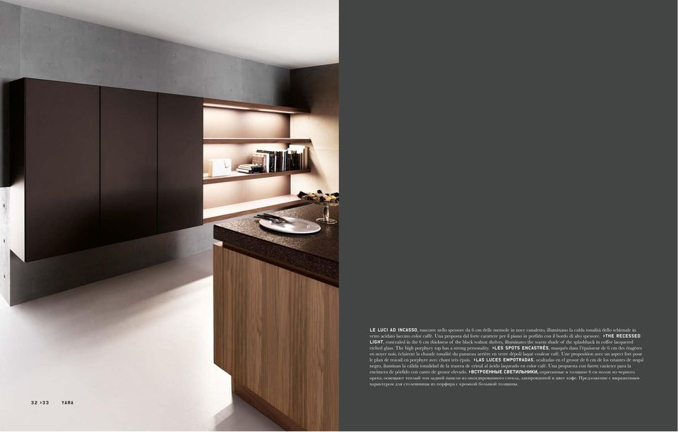 >The recessed light, concealed in the 6 cm thickness of the black walnut shelves, illuminates the warm shade of the splashback in coffee lacquered etched glass.