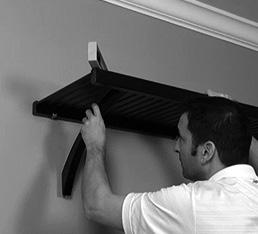 Place angle bracket into position Ensure that the angle bracket is flush with the back wall and the underside of the front shelf rail. 8.