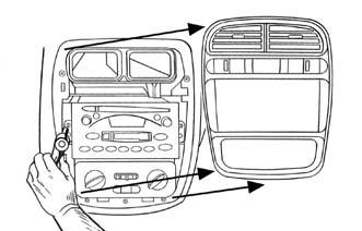 Unclip and remove the trim panel surrounding the radio. 2. Remove (2) 9/32 screws from radio to remove.